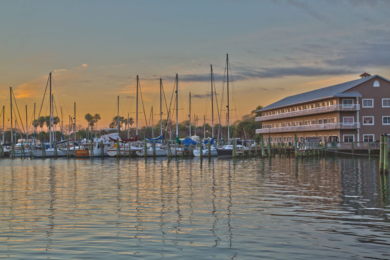 View of Cocoa Village Dentistry's office at the marina at Mariner Square with boats at the docks